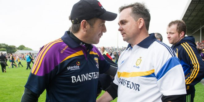 Wexford manager Liam Dunne and former Clare manager Davy Fitzgerald following their All-Ireland qualifier replay at Wexford Park in 2014. Photograph by John Kelly.