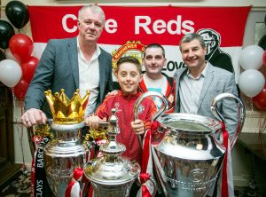 Gary Pallister and Denis Irwin with with Jack (10) and Mikey Dunleavy, Ennis. Photograph by Arthur Ellis.