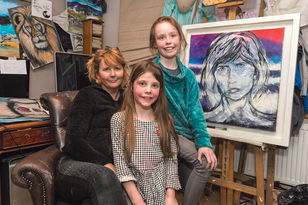 Carmel Doherty of Ennis Art School with two of her young proteges Laurie Hehir and her sister Honor. Laurie was the youngest prize winner in the 2019 Texaco Children's Art Competition.