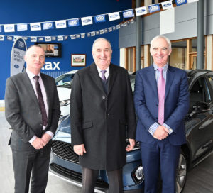 James Hehir (centre) with Eddie Rynne, General Manager and Thomas Sheils, Managing Director on James' retirement from Sheils Motor Group.
